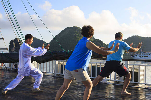 Tai Chi exercise at Halong Bay thing to try in Vietnam Cambodia & Laos trip