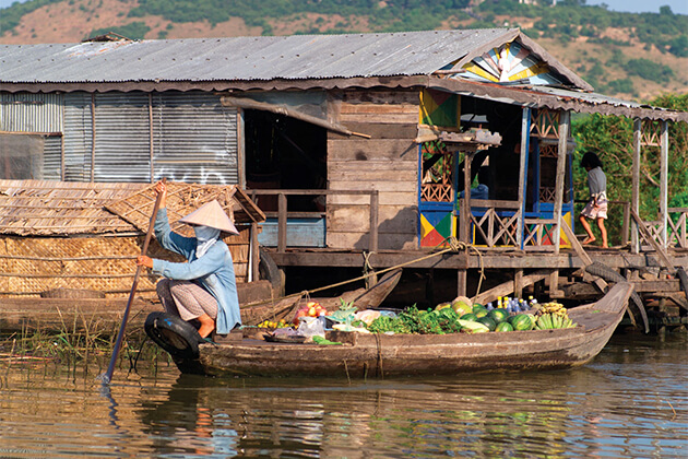 Woman-boat-vegetables-Tonle-Sap-Cambodia in Siem reap